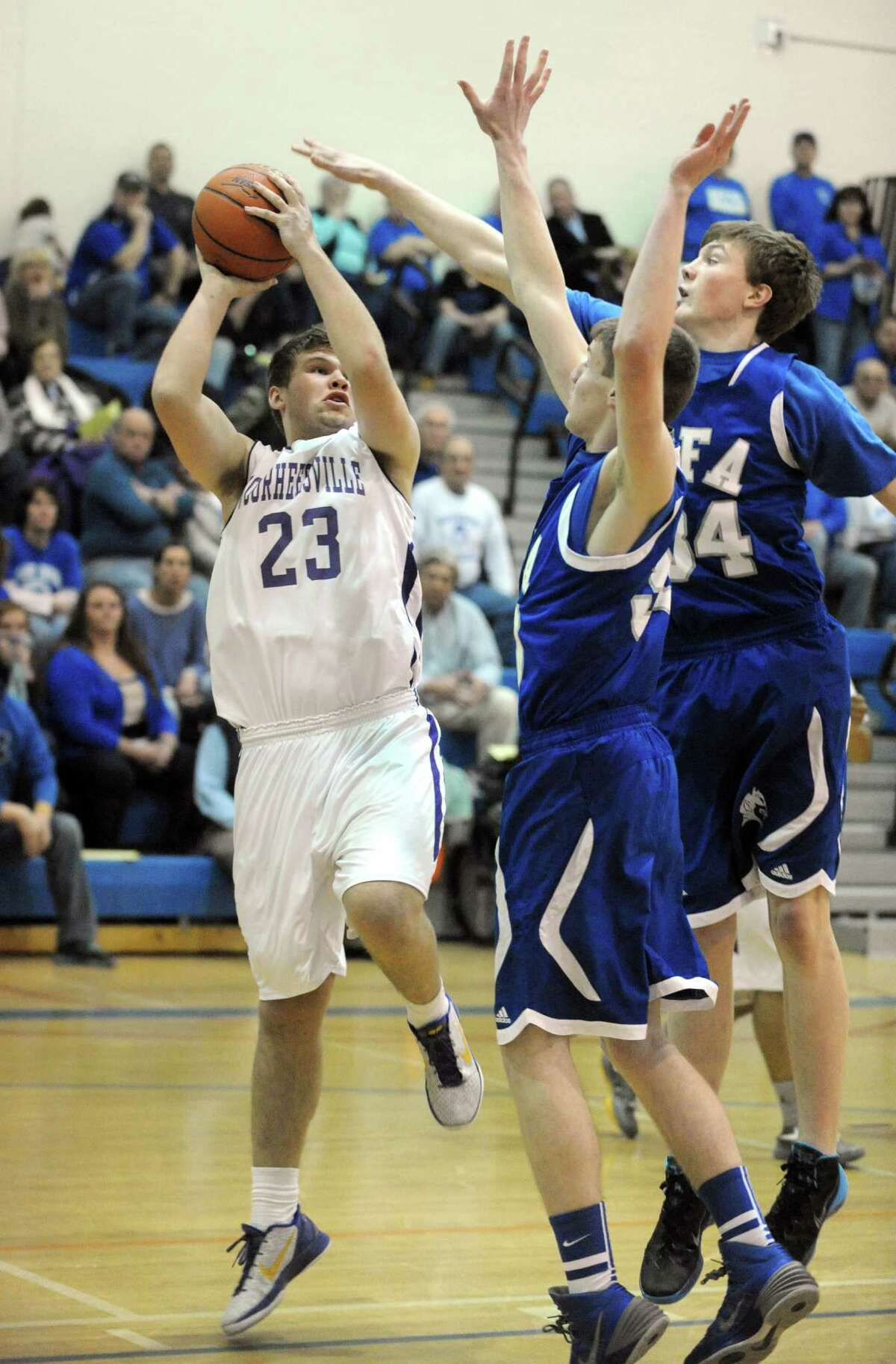 Voorheesville's Logan Hotaling goes to the basket during their Class B state regional boys' basketball game against Ogdensburg Free Academy on Tuesday March 4, 2014 in Saratoga Springs, N.Y. (Michael P. Farrell/Times Union)