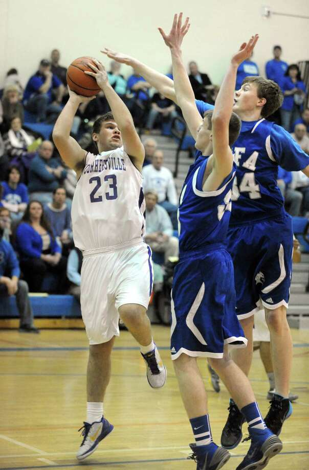 Voorheesville's Logan Hotaling goes to the basket during their Class B state regional boys' basketball game against Ogdensburg Free Academy on Tuesday March 4, 2014 in Saratoga Springs, N.Y. (Michael P. Farrell/Times Union) Photo: Michael P. Farrell / 00025988A