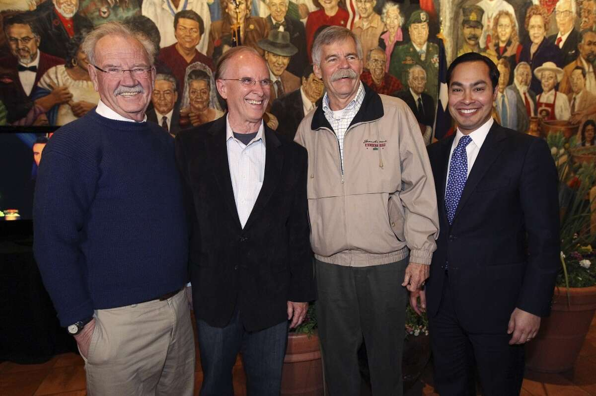 Bexar County Judge Nelson Wolff (second from left) joins former city mayors Phil Hardberger (left) and Howard Peak (second from right) along with current mayor Julian Castro for a photo-op at Mi Tierra as they monitor election night results with supporters on Tuesday, Mar. 4, 2014. Wolff ran against Bexar County Commissioner Tommy Adkisson. (Kin Man Hui/San Antonio Express-News)