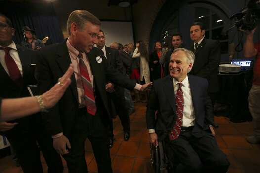 Texas Attorney General Greg Abbott greets supporters, including Steve Duffy, left, at Aldaco's Sunset Station after winning the Republican nomination for Texas governor, Tuesday, March 4, 2014. Abbott will face Democrat Wendy Davis in the November general election. Photo: Jerry Lara, San Antonio Express-News