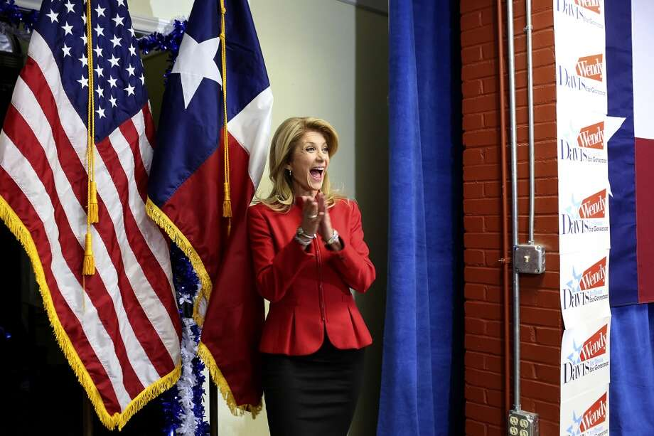 State Senator and Democratic gubernatorial candidate Wendy Davis arrives to the cheers of her supporters as she walks out from behind the stage to speak to them during the primary election watch party at her campaign headquarters in Fort Worth on Tuesday, March 4, 2014. Photo: Lisa Krantz, San Antonio Express-News