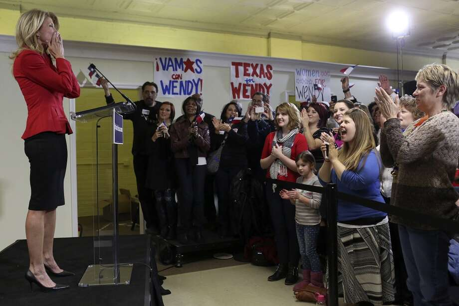 State Senator and Democratic gubernatorial candidate Wendy Davis kisses her hands to blow a kiss to her supporters at the conclusion of her speech during the primary election watch party at her campaign headquarters in Fort Worth on Tuesday, March 4, 2014. Photo: Lisa Krantz, San Antonio Express-News