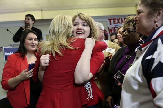 Samantha Bauman embraces State Senator and Democratic gubernatorial candidate Wendy Davis after Davis' speech during the primary election watch party at her campaign headquarters in Fort Worth on Tuesday, March 4, 2014. Bauman is a student at Texas Christian University. Photo: Lisa Krantz, San Antonio Express-News