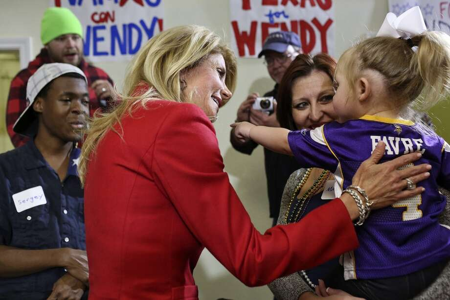 State Senator and Democratic gubernatorial candidate Wendy Davis speaks to supporters including birthday girl Sadie Granberry, 2, held by her mother, Maricia Grandberry, right, during the primary election watch party at her campaign headquarters in Fort Worth on Tuesday, March 4, 2014. Photo: Lisa Krantz, San Antonio Express-News