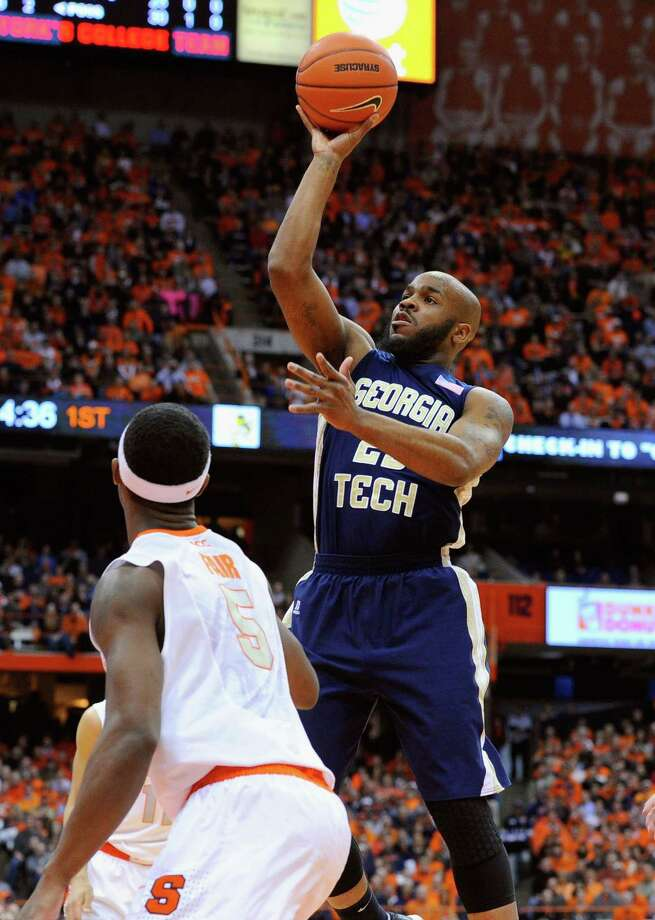 SYRACUSE, NY - MARCH 04:  Trae Golden #23 of the Georgia Tech Yellow Jackets takes a shot over C.J. Fair #5 of the Syracuse Orange during the first half at the Carrier Dome on March 4, 2014 in Syracuse, New York.  (Photo by Rich Barnes/Getty Images) ORG XMIT: 185399005 Photo: Rich Barnes / 2014 Getty Images