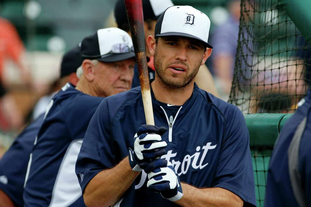 Detroit Tigers second baseman Ian Kinsler, center, waits his turn in the batting cage before an exhibition spring training baseball game between the Detroit Tigers and the Pittsburgh Pirates in Lakeland, Fla., Tuesday, March 4, 2014. Kinsler says comments attributed to him in a recent magazine story were taken out of context. Kinsler was quoted as saying he hopes Texas goes 0-162 this year after trading him in the offseason. He's also quoted as calling Rangers general manager Jon Daniels a