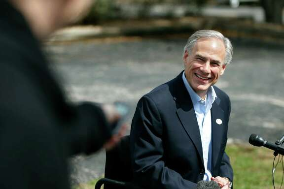 Republican gubernatorial candidate Greg Abbott speaks to the news media after voting Tuesday.