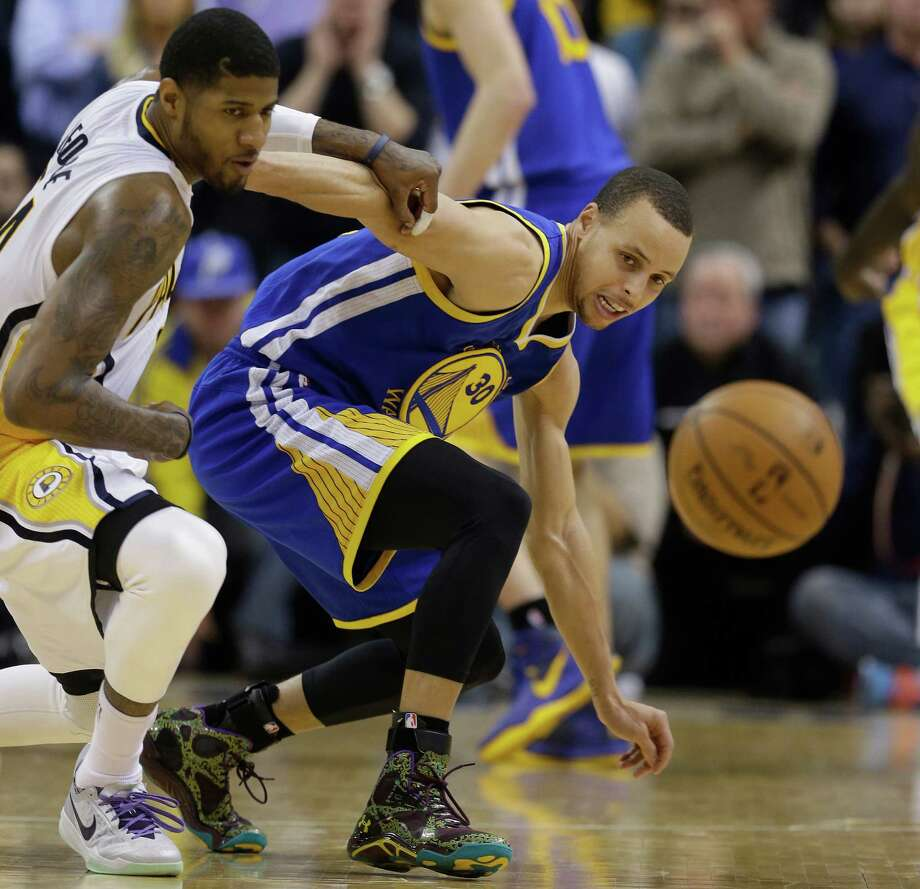 Indiana Pacers' Paul George (24) and Golden State Warriors' Stephen Curry (30) eye a loose ball during the second half of an NBA basketball game Tuesday, March 4, 2014, in Indianapolis. Golden State defeated Indiana 98-96. (AP Photo/Darron Cummings)  ORG XMIT: NAF111 Photo: Darron Cummings / AP