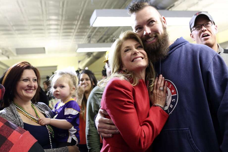 State Senator and Democratic gubernatorial candidate Wendy Davis poses with supporter Marty Edwards as a friend photographs them during the primary election watch party at her campaign headquarters in Fort Worth on Tuesday, March 4, 2014. Photo: SAN ANTONIO EXPRESS-NEWS