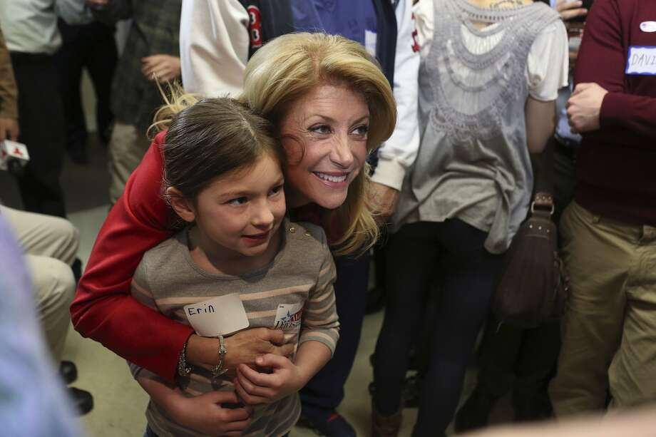 State Senator and Democratic gubernatorial candidate Wendy Davis embraces supporters including Erin Beck-Johnson, 6, after her speech during the primary election watch party at her campaign headquarters in Fort Worth on Tuesday, March 4, 2014. Photo: SAN ANTONIO EXPRESS-NEWS