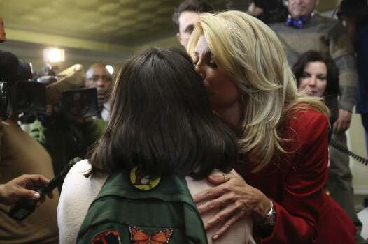 State Senator and Democratic gubernatorial candidate Wendy Davis embraces supporter Jessica Womack, a campaign volunteer who brought her five children to the event, during the primary election watch party at her campaign headquarters in Fort Worth on Tuesday, March 4, 2014. Photo: SAN ANTONIO EXPRESS-NEWS