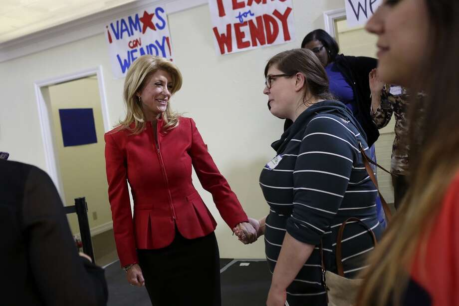State Senator and Democratic gubernatorial candidate Wendy Davis talks with supporter Bekah Boyer, right, during the primary election watch party at her campaign headquarters in Fort Worth on Tuesday, March 4, 2014. Photo: SAN ANTONIO EXPRESS-NEWS