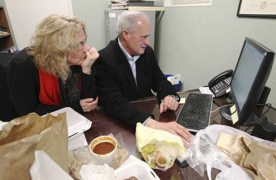 Bexar County Commissioner Tommy Adkisson along with his wife, Karen, review election night results at his campaign headquarters on Tuesday, Mar. 4, 2014. Adkisson ran against Bexar County Judge Nelson Wolff. (Kin Man Hui/San Antonio Express-News) Photo: San Antonio Express-News