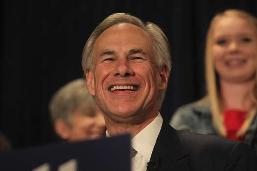 Texas Attorney General Greg Abbott smiles at Aldaco's Sunset Station after winning the Republican nomination for Texas Governor, Tuesday, March 4, 2014. Abbott will face Democrat Wendy Davis in the November general election. Behind Abbott is his daughter, Audrey. Photo: San Antonio Express-News