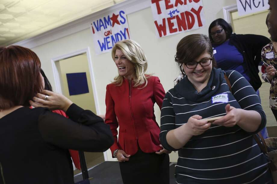 State Senator and Democratic gubernatorial candidate Wendy Davis greets supporters after her speech during the primary election watch party at her campaign headquarters in Fort Worth on Tuesday, March 4, 2014. Photo: SAN ANTONIO EXPRESS-NEWS