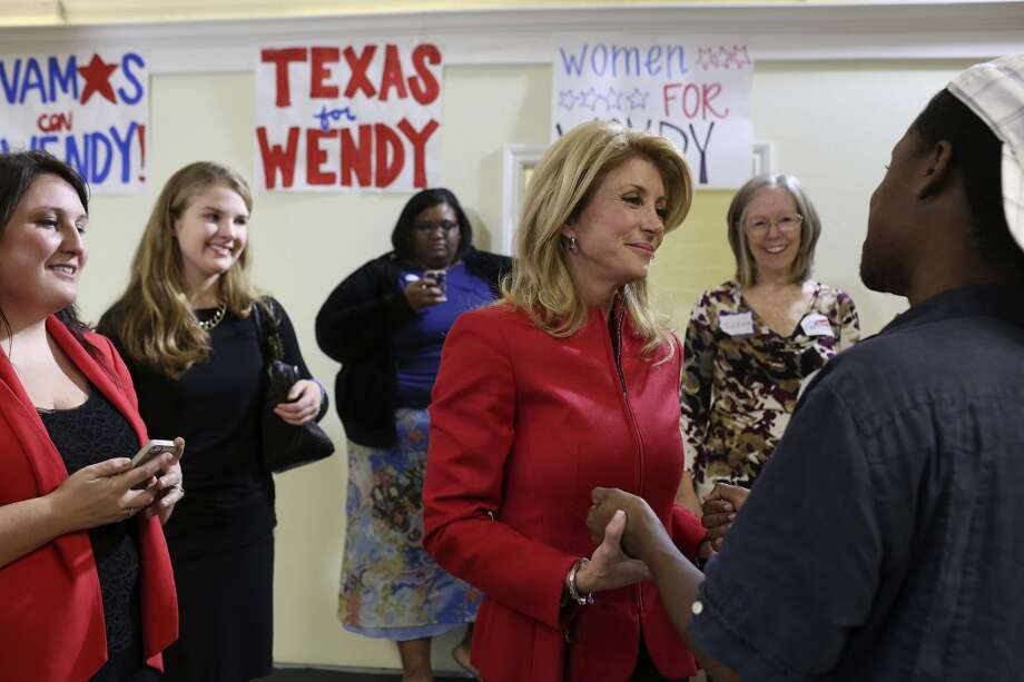 State Senator and Democratic gubernatorial candidate Wendy Davis talks with supporter Sergey Kyle during the primary election watch party at her campaign headquarters in Fort Worth on Tuesday, March 4, 2014. Photo: SAN ANTONIO EXPRESS-NEWS