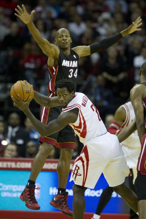 Rockets point guard Pat Beverley looks to pass as Ray Allen of the Heat defends. Photo: Brett Coomer, Houston Chronicle