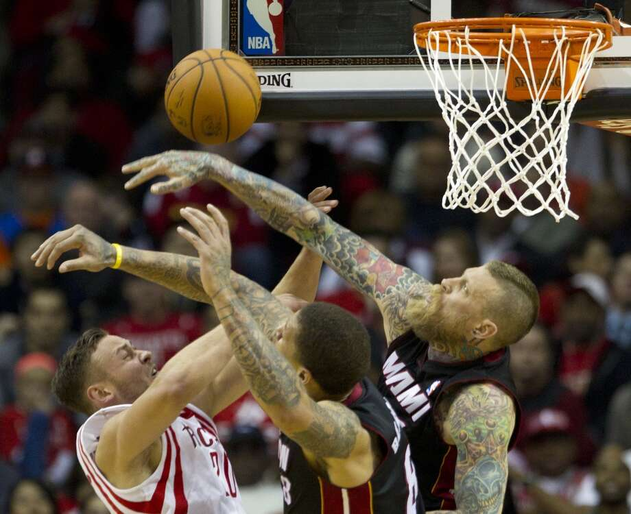 Chris Andersen of the Heat blocks a shot from Rockets forward Donatas Motiejunas. Photo: Brett Coomer, Houston Chronicle