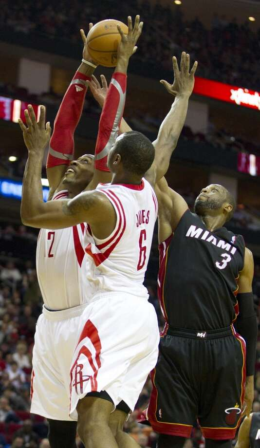 Rockets center Dwight Howard gets a rebound against Dwyane Wade of the Heat. Photo: Brett Coomer, Houston Chronicle