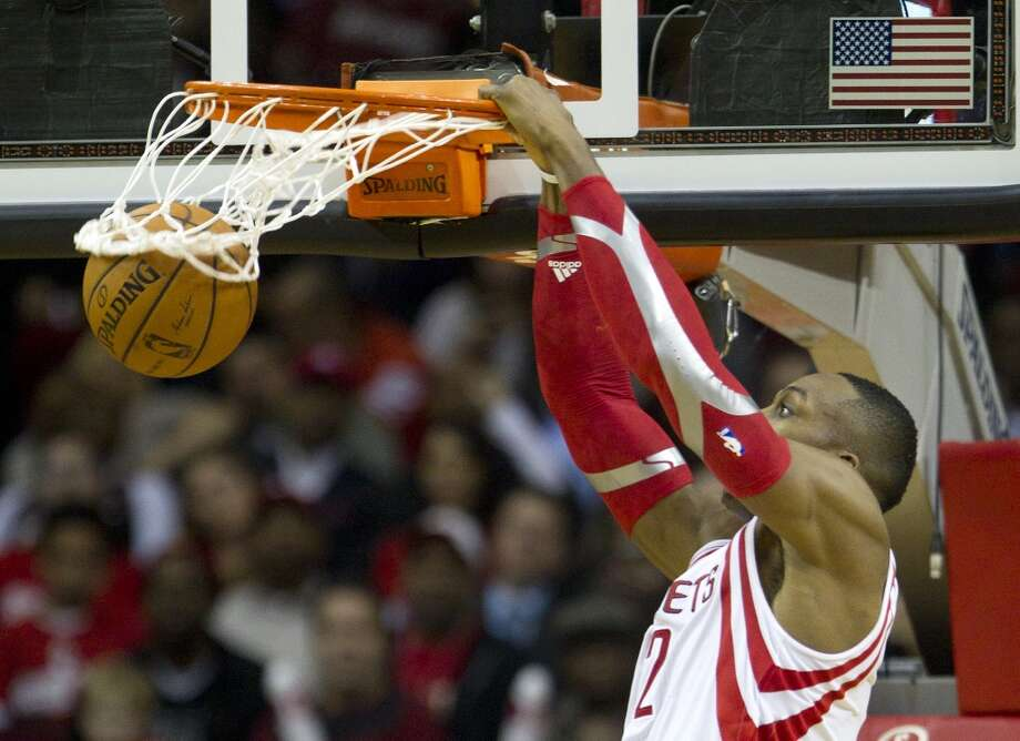 Rockets center Dwight Howard gets a slam dunk versus the Heat. Photo: Brett Coomer, Houston Chronicle