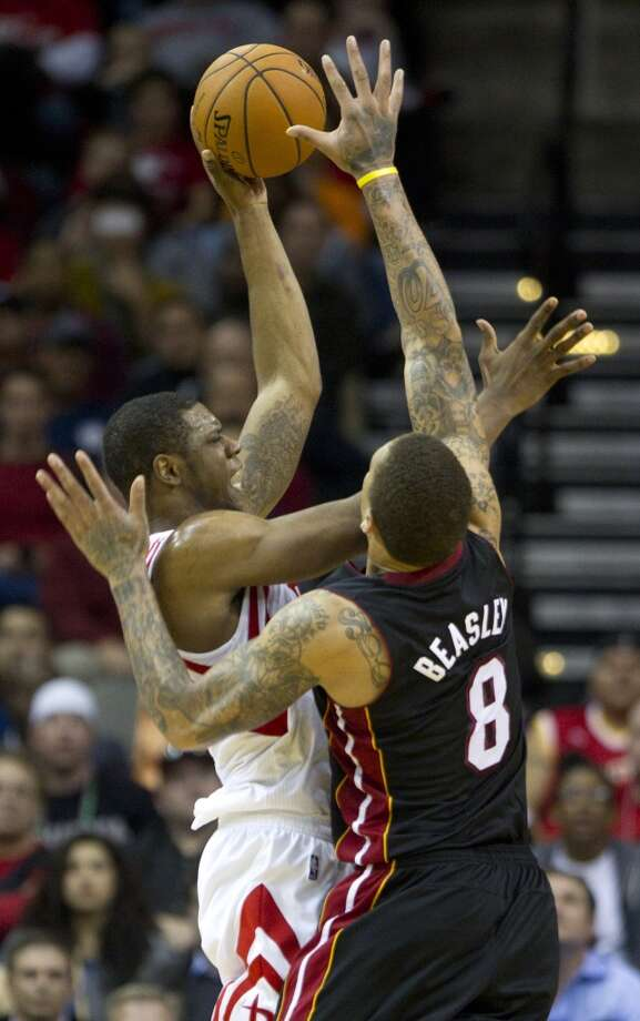 Rockets forward Terrence Jones attempts a shot against Michael Beasley of the Heat. Photo: Brett Coomer, Houston Chronicle