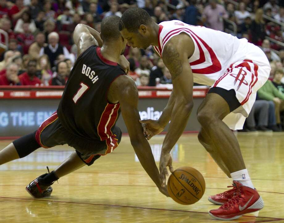 Rockets forward Terrence Jones battles for possession with Chris Bosh of the Heat. Photo: Brett Coomer, Houston Chronicle