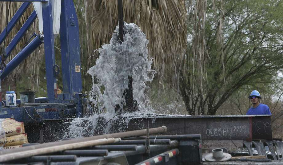 This was the scene last month as the 120-year-old well at Hot Wells was permanently capped because it had fallen into disrepair. Photo: San Antonio Express-News / File Photo / ©2013 San Antonio Express-News