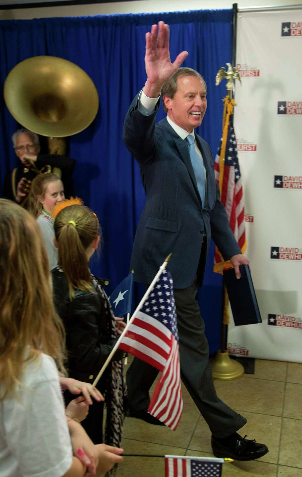 Texas Lt. Gov. David Dewhurst waves to supporters as he enters a news conference after a runoff was predicted against Republican primary challenger Dan Patrick in Houston, Tuesday, March 4, 2014. (AP Photo/Richard Carson)