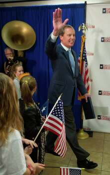 Texas Lt. Gov. David Dewhurst waves to supporters as he enters a news conference after a runoff was predicted against Republican primary challenger Dan Patrick in Houston, Tuesday, March 4, 2014. (AP Photo/Richard Carson) Photo: Richard Carson, Associated Press / FR171014 AP