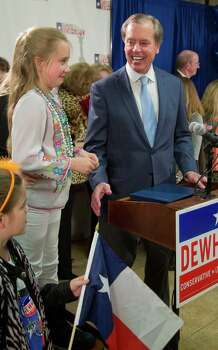 Texas Lt. Gov. David Dewhurst stands with daughter Carolyn, 10, left, as he talks to supporters and the media after announcing a runoff with Republican primary challenger Dan Patrick in Houston, Tuesday, March 4, 2014. (AP Photo/Richard Carson) Photo: Richard Carson, Associated Press / FR171014 AP