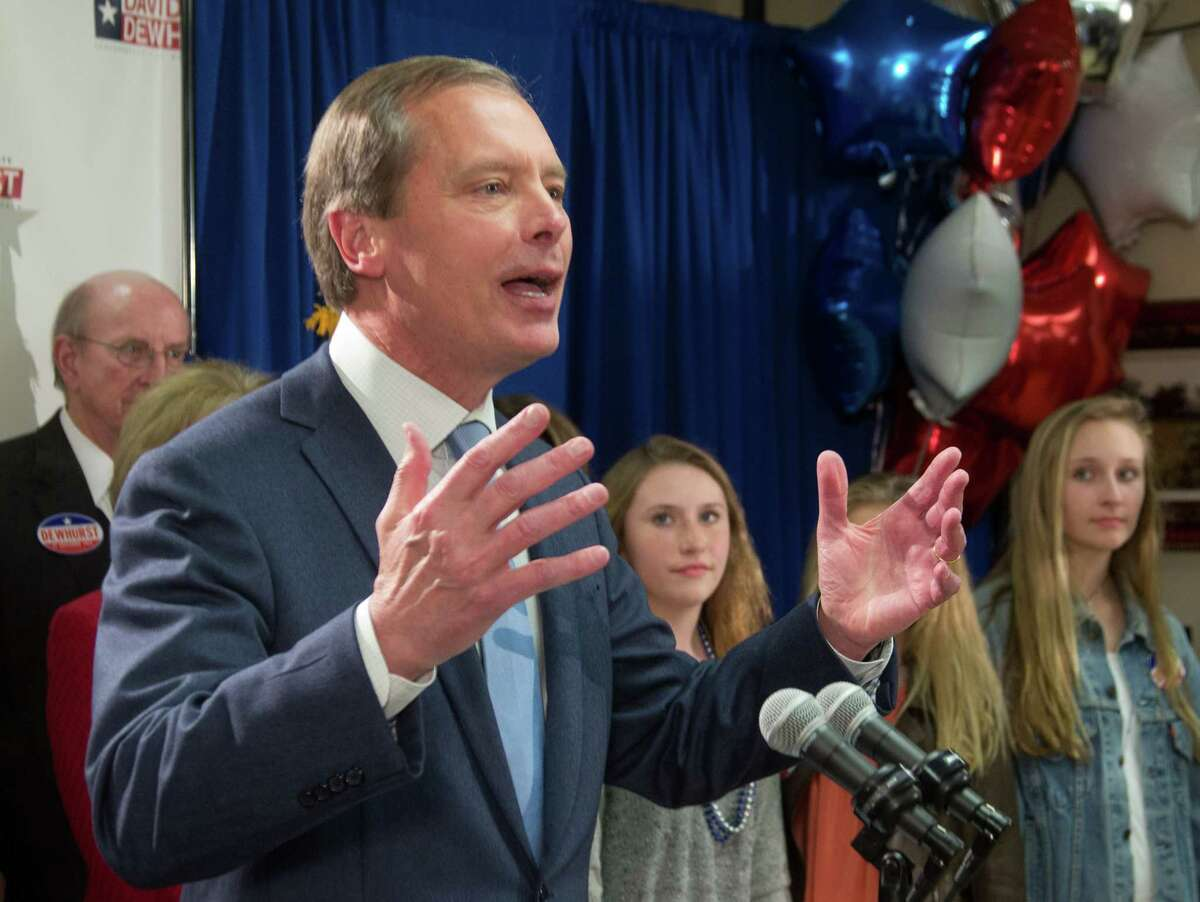 Texas Lt. Gov. David Dewhurst talks to supporters and the media after a runoff was predicted against Republican primary challenger Dan Patrick in Houston, Tuesday, March 4, 2014. (AP Photo/Richard Carson)