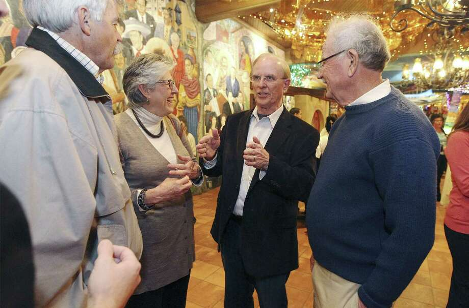 Bexar County Judge Nelson Wolff meets with former Mayors Howard Peak (at left) and Phil Hardberger, along with Hardberger's wife, Linda, at Mi Tierra. Photo: Kin Man Hui / San Antonio Express-News / ©2013 San Antonio Express-News