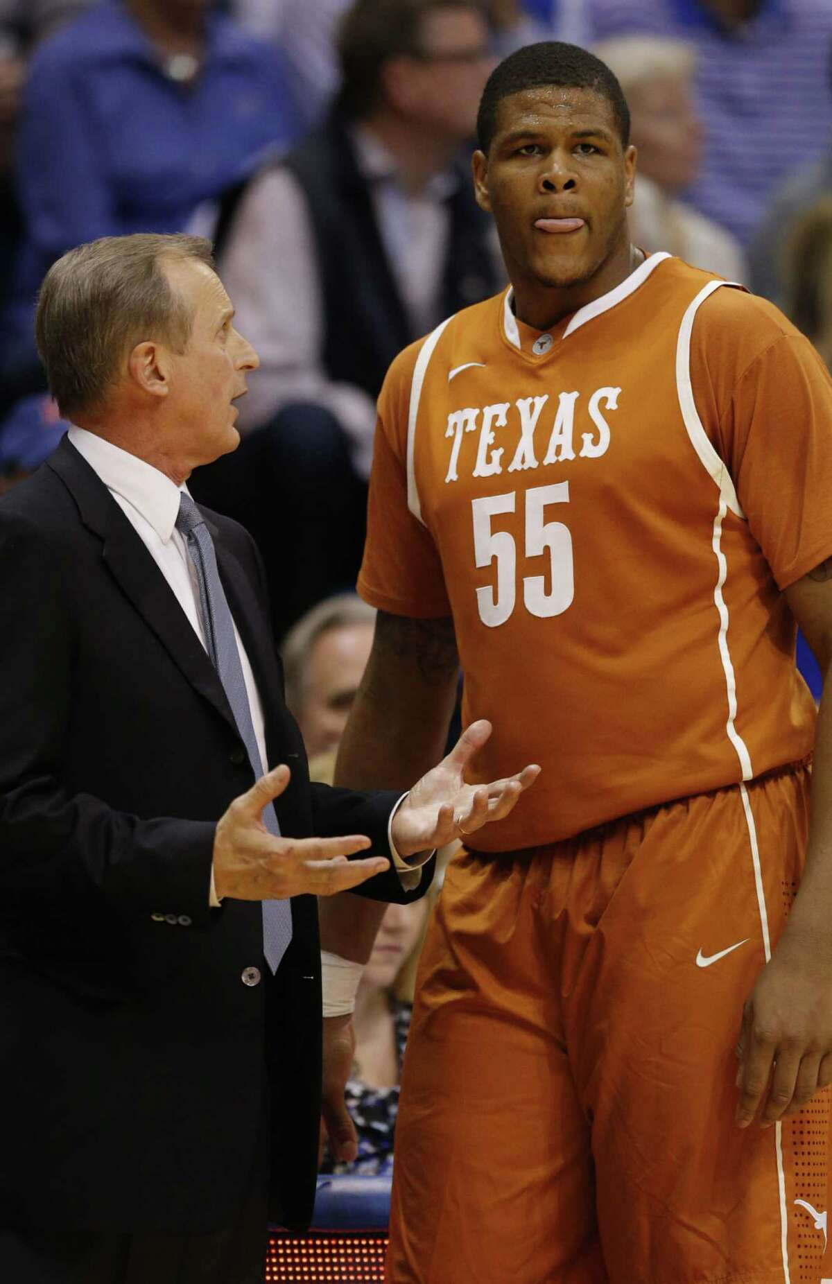 Texas head coach Rick Barnes and center Cameron Ridley (55) during the second half of an NCAA college basketball game against Kansas in Lawrence, Kan., Saturday, Feb. 22, 2014. Kansas defeated Texas 85-54. (AP Photo/Orlin Wagner)
