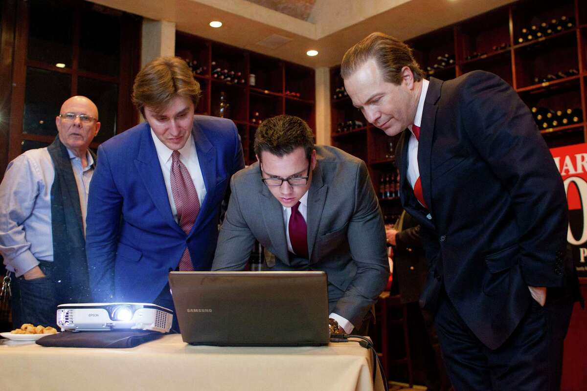 From left, Mark Lipkin, John Griffing, Jonathan Nessmith and incumbent Harris County Republican Party Chairman Jared Woodfill look at voting numbers.