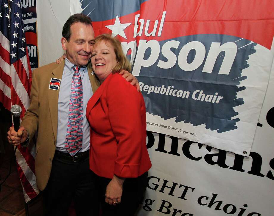 Harris County Republican Party chairman candidate Paul Simpson celebrates with his wife, Kathy, after defeating incumbent Jared Woodfill. Photo: Billy Smith II, Staff / © 2014 Houston Chronicle