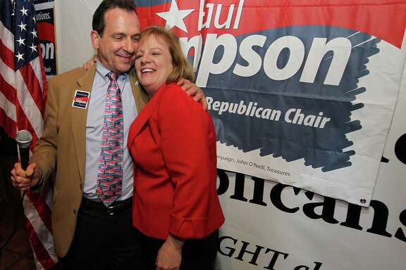 Harris County Republican Party chairman candidate Paul Simpson celebrates with his wife, Kathy, after defeating incumbent Jared Woodfill.