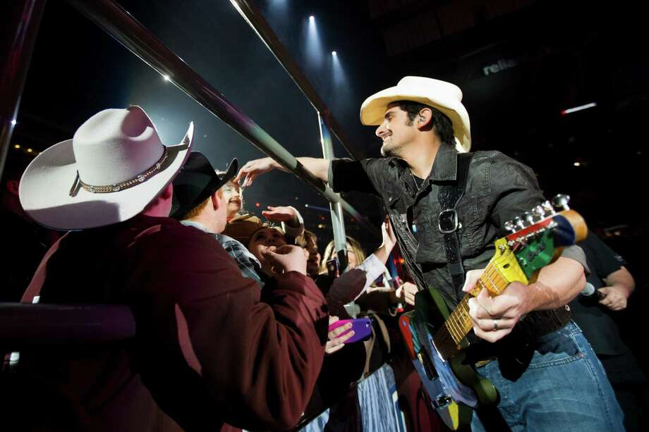 Brad Paisley shares a moment with his fans during his  performance at Reliant Stadium during the opening night of the Houston Livestock Show and Rodeo, Tuesday, March 4, 2014, in Houston. Photo: Marie D. De Jesús, Houston Chronicle / © 2014 Houston Chronicle
