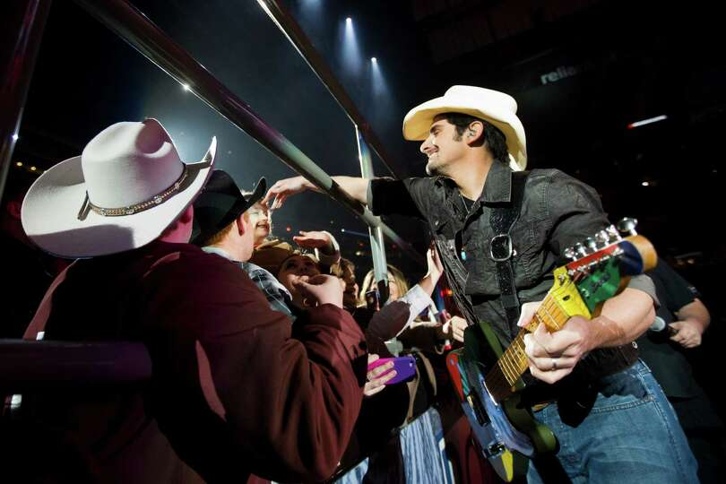 Brad Paisley shares a moment with his fans during his  performance at Reliant Stadium during the ope