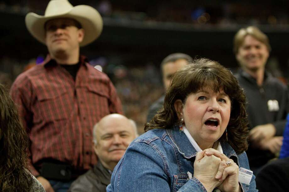 Debbi Lonsway of Webster reacts to the youth competing on the calf scramble competition during the opening night of the Houston Livestock Show and Rodeo, Tuesday, March 4, 2014, in Houston. Photo: Marie D. De Jesús, Houston Chronicle / © 2014 Houston Chronicle