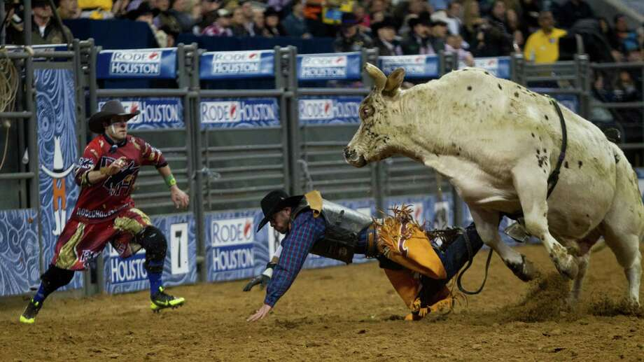 Michael Riggs falls on the Reliant Stadium arena while competing in the BP Super Series I Round 1 Bull Riding competition during Houston Livestock Show and Rodeo Tuesday, March 4, 2014, in Houston. Photo: Marie D. De Jesús, Houston Chronicle / © 2014 Houston Chronicle