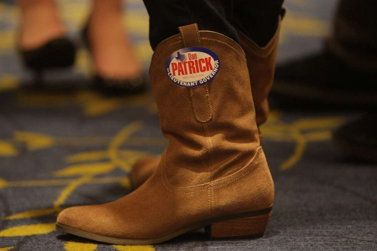 A Dan Patrick supporter with a campaign decal on her boot. ( James Nielsen / Houston Chronicle )