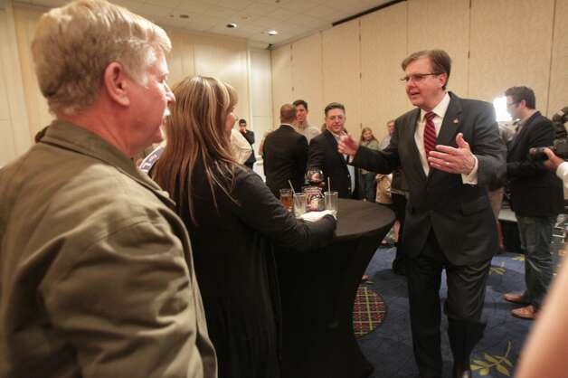 Lt. Governor candidate Dan Patrick right, greets Sylvia Withrow center, as her husband Gerry Withrow left, looks on at Patrick's election watch party.  ( James Nielsen / Houston Chronicle ) Photo: James Nielsen, Houston Chronicle