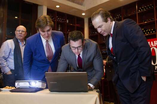 "Next to Mark Lipkin, left, John Griffing, and Jonathan Nessmith, center right, Harris County Republican Party Chairman Jared Woodfill, right, looks at voting numbers during his election watch party at the Grotto Ristorante Tuesday, March 4, 2014, in Houston. Woodfill was running for the seat against Paul Simpson and Wendy McPherson Berry. ""Looks like we are going to have a runoff, but we'll see,"" Woodfill said. ( Johnny Hanson / Houston Chronicle ) Photo: Johnny Hanson, Houston Chronicle"