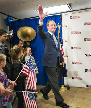 Texas lieutenant governor candidate Lt. Gov. David Dewhurst waves to supporters as he arrives for an election night party at his Houston campaign headquarters on Tuesday, March 4, 2014, in Houston.  Dewhurst faces three Republican challengers for re-election in the primary. ( Smiley N. Pool / Houston Chronicle ) Photo: Smiley N. Pool, Houston Chronicle
