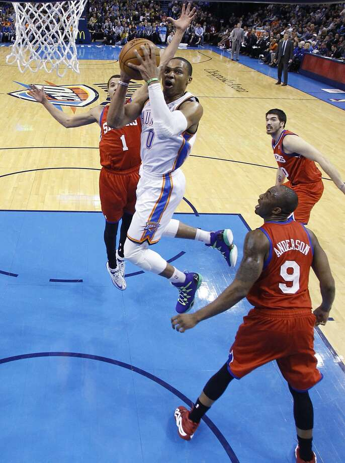 Oklahoma City's Russell Westbrook had a triple double in 21 minutes as the Thunder topped the 76ers in their most lopsided victory of the season. Photo: Sue Ogrocki, Associated Press