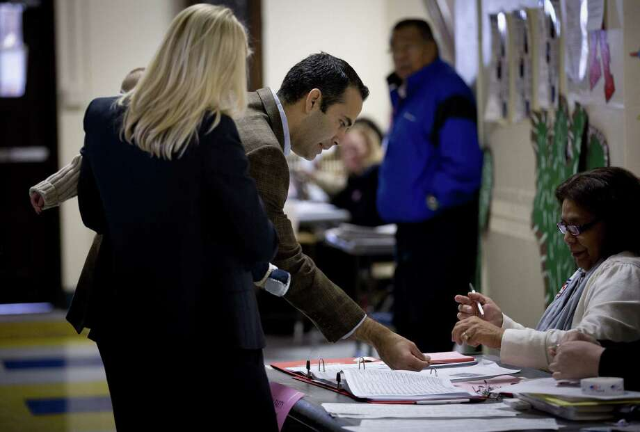 George P. Bush, running for Texas land commissioner, and his wife, Amanda, holding son Prescott, prepare to vote at an elementary school in Fort Worth. Photo: Joyce Marshall / Fort Worth Star-Telegram / The Fort Worth Star-Telegram
