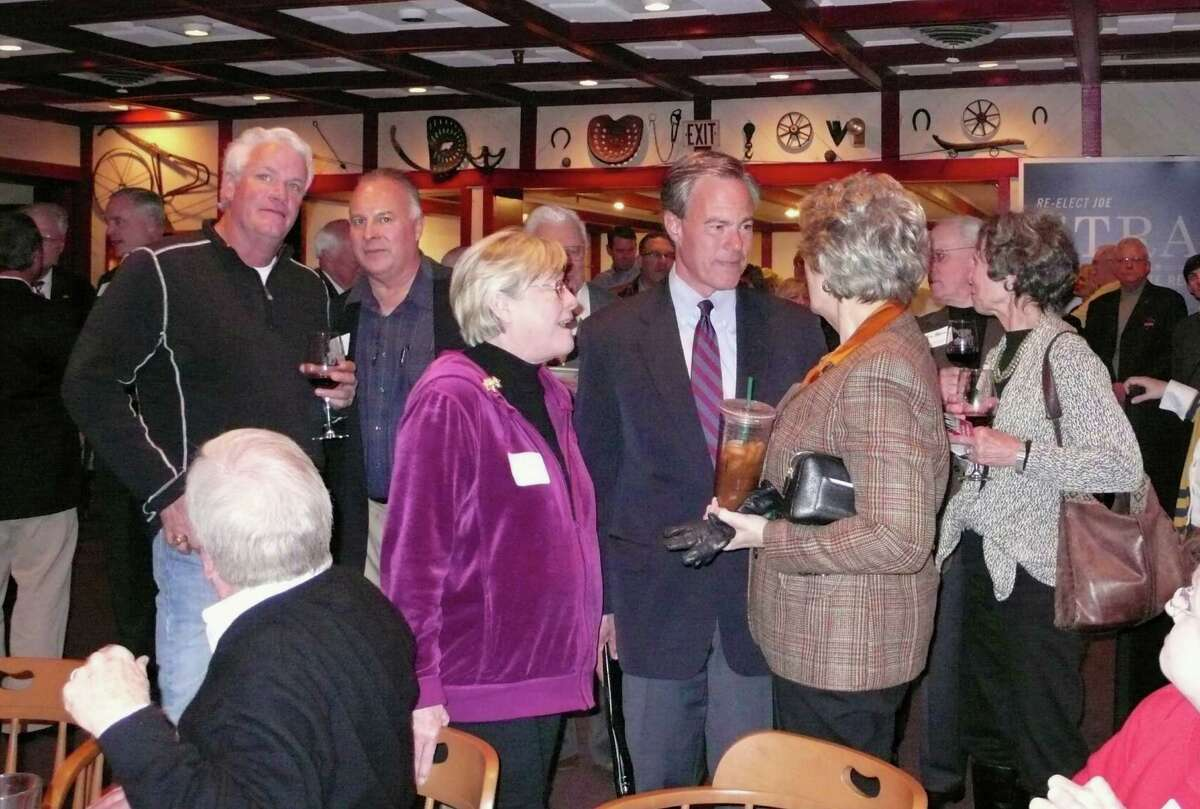 Texas House Speaker Joe Straus, R-San Antonio, accepts congratulations from Bexar County Sheriff Susan Pamerleau and other supporters Tuesday night at the Barn Door Restaurant in San Antonio, where Straus declared victory over GOP challenger Matt Beebe in District 121.