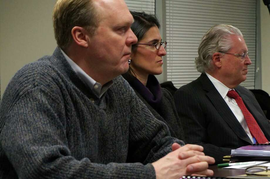 Members of the Board of Selectmen, from left, Kevin Kiley, Cristin McCarthy-Vahey and Michael Tetreau, at a meeting Tuesday on the 2014-15 budget with the Board of Finance. Photo: Genevieve Reilly / Fairfield Citizen