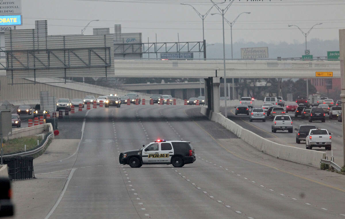 A San Antonio police car is parked in the middle of Loop 410 westbound Wednesday March 5, 2014 near the IH-10 interchange after a Federal Express truck crashed about 3:45 in the morning. The crashed killed the truck's diver and traffic on Loop 410 westbound is backed up for miles.