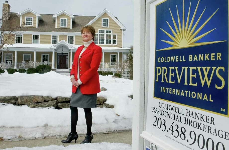 Cathleen Smith, president of Ridgefield-based Coldwell Banker, in front of a house her firm is representing in Ridgefield, Conn. on Wednesday, March 5, 2014. Photo: Scott Mullin / The News-Times Freelance